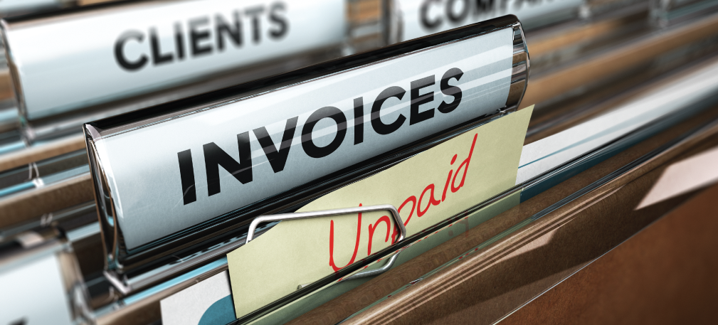 Unpaid invoices in filing cabinet